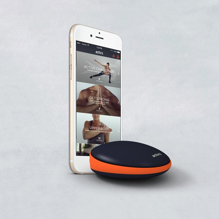 Telephone with fitness images and a black and orange device in front