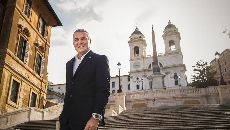 Jean-Christophe Babin poses before an ancient white church on Rome's Spanish Steps
