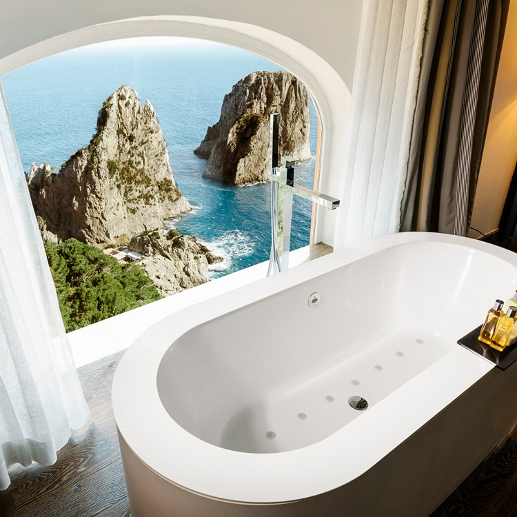 An elegant bath tub overlooking the Faraglioni rocks at the Punta Tragara hotel in Capri