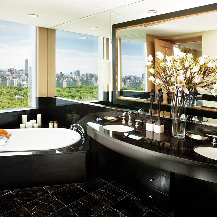 The sleek black marble bathroom at Mandarin Oriental, New York overlooking Central Park