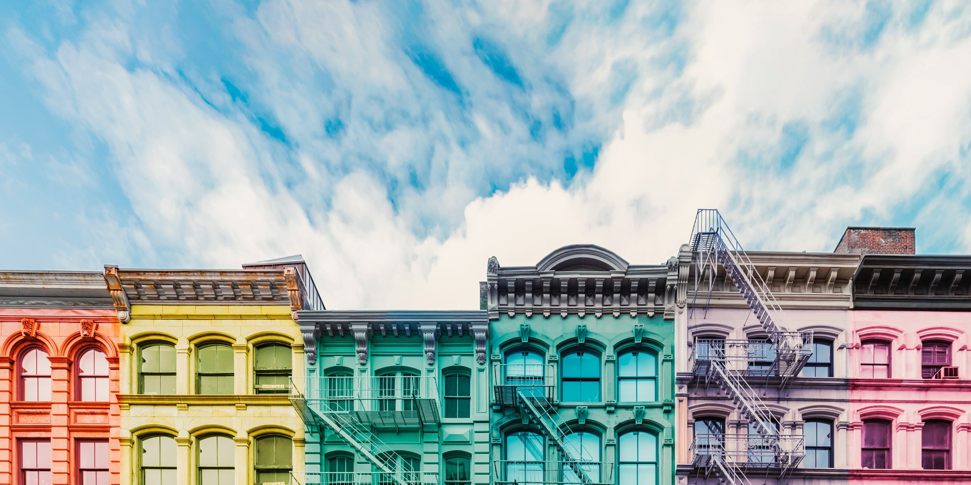 A row of New York houses painted rainbow colours