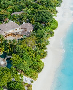 Aerial view of a deluxe villa at paradise on earth resort in the Maldives