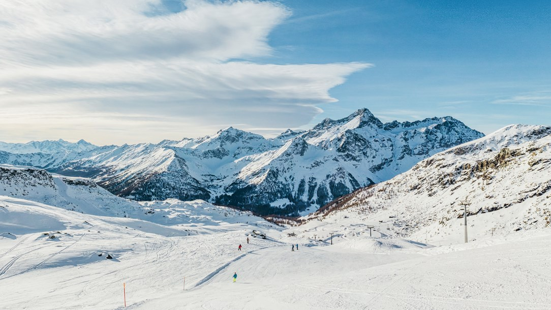 View across a valley and ski resort in the Italian Alps