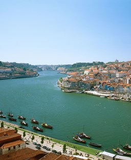 Porto city on the bend of a river on a calm summer day