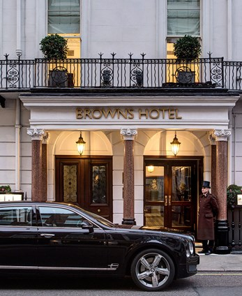 The exterior of Browns Hotel with a luxury car outside