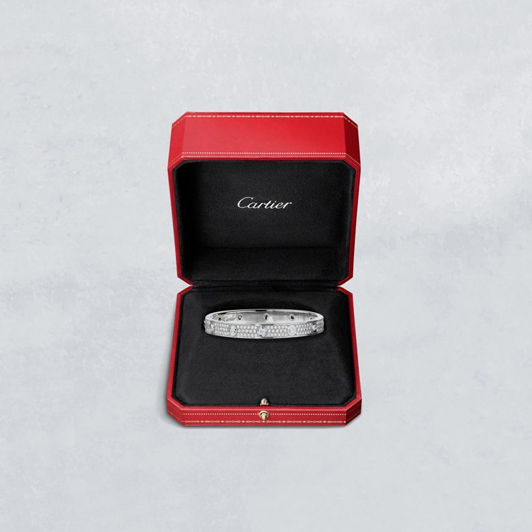 Diamond Cartier ring in a red gift box