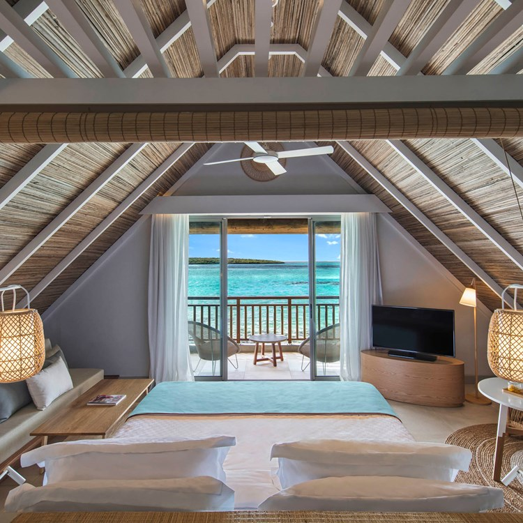 Interior shot of a hotel room with a view of the ocean